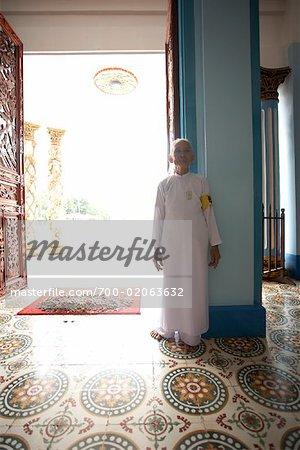 Monk at Cao Dai Temple Entrance, Vietnam
