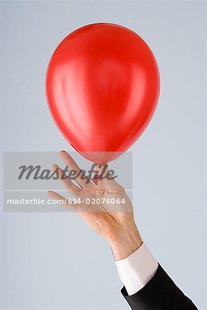 Person holding a balloon