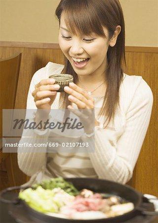 Woman Having a Japanese Sake