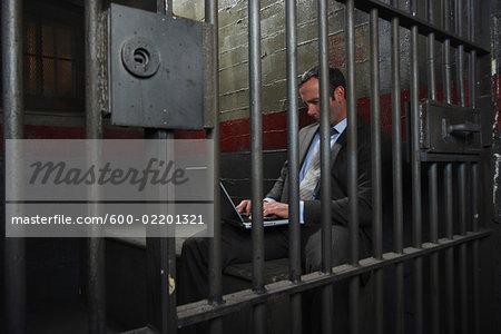 Man Using Laptop in Jail