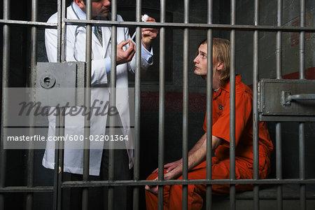 Doctor Preparing Needle for Prisoner