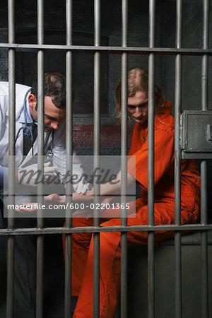 Doctor Giving Prisoner Injection