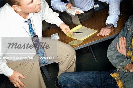 Detectives Interrogating Man