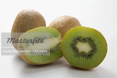 Kiwi fruits, whole and halved (lengthwise and crosswise)