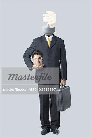 Businessman with a light bulb on his head