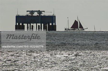 Flat-Bottomed Sailboat Near Offshore Platform, Wadden Sea, Friesland, Netherlands