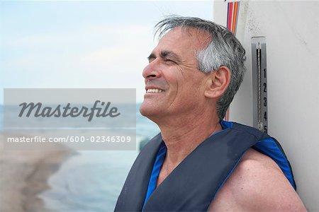 Portrait of Man with Windsurfer