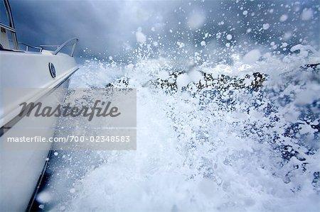 Motorboat Splashing Through Waves