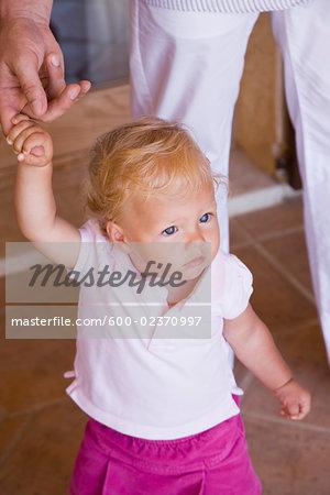 Little Girl Holding Parent's Finger