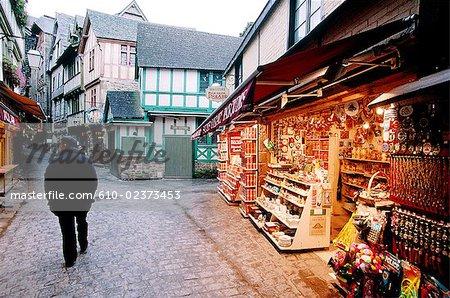 """France, Normandy, Mont Saint-Michel, """"Grande rue"""" at dusk, souvenirs shops"""