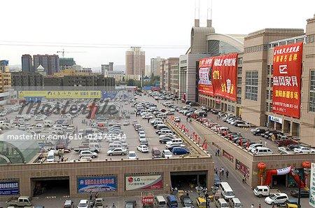 China, Xinjiang, Urumqi, commercial center, parking