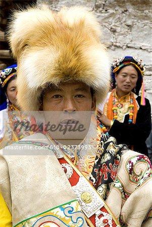 China, Sichuan, near Danba, village festival, portrait of a Tibetan wearing traditional costume