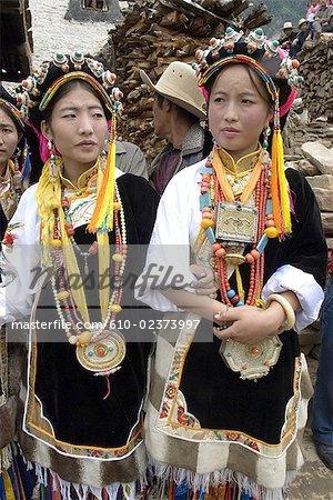 China, Sichuan, near Danba, village festival, woman wearing Tibetan traditional jewels