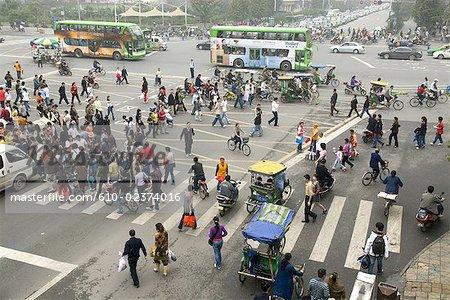 China, Sichuan, Chengdu, downtown, pedestrians at a crossroad