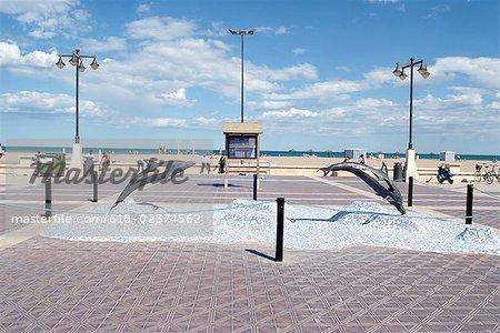 Spain, Valencia, Levante/Las Arenas beach, dolphins sculptures