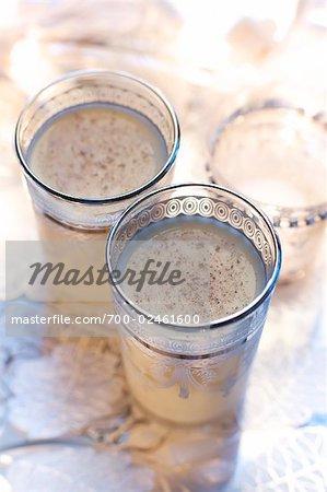 Glasses of Eggnog and Chai Tea