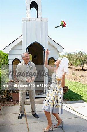 Bride Tossing Bouquet Outside Chapel, Niagara Falls, Ontario, Canada