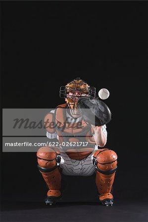 Baseball catcher catching ball