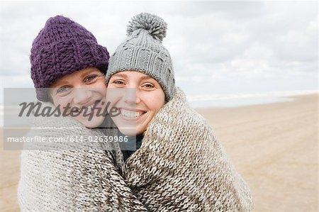 Women sharing a blanket