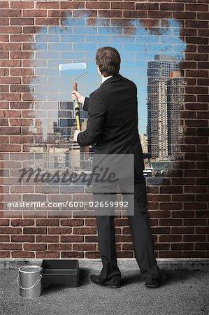 Homme d'affaires Cityscape de peinture sur le mur de brique