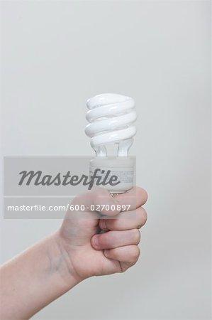 Child Holding Energy Efficient Lightbulb