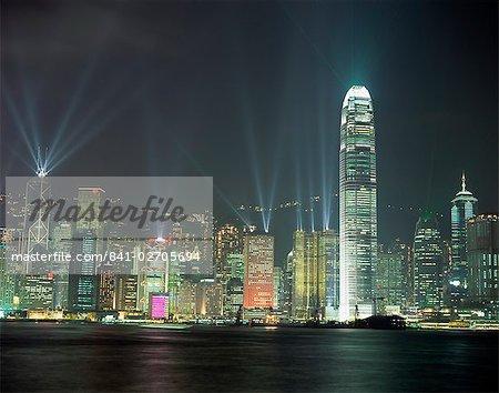 Hong Kong city skyline looking across Victoria harbour to Hong Kong Island at night, Hong Kong, China, Asia