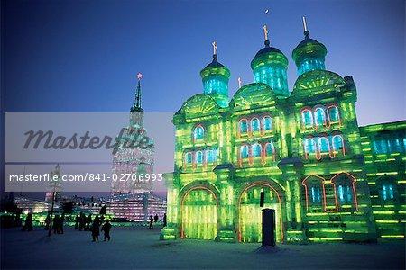 Ice buildings lit at night, Ice Lantern Festival, Bingdeng Jie, Harbin city, Heilongjiang, China, Asia