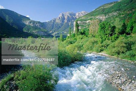 Torla, the River Ara and distant Mondarruego, Huesca (Pyrenees), Aragon, Spain, Europe