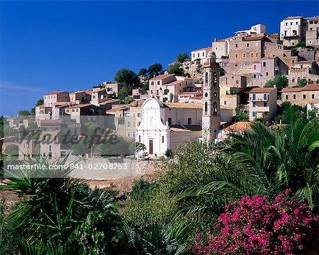 View of church and village on hillside, Lumio, near Calvi, Haute-Corse, Corsica, Mediterranean, France, Europe