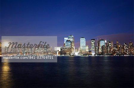 Full moon rising over Lower Manhattan skyline across the Hudson River, New York City, New York, United States of America, North America