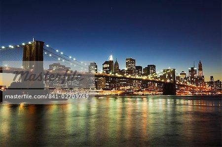 Brooklyn Bridge and Manhattan skyline at dusk, New York City, New York, United States of America, North America