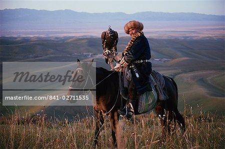 Kazakh herdsmen on horseback, with hunting eagle, Sarsembek, Kazakhstan, Central Asia, Asia
