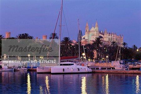 Palma cathedral from the harbour at dusk, Palma de Mallorca, Majorca, Balearic Islands, Spain, Mediterranean, Europe