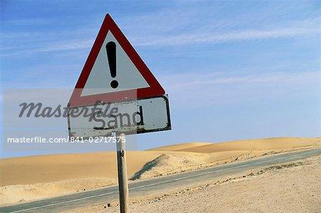 Road sign warning of sand, Swamopmund, Namibia, Africa