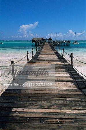 Bridge leading to a bar on the water, Kiwengwa beach, Zanzibar, Tanzania, East Africa, Africa