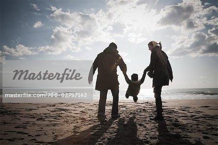 Family on Beach in Winter, Lazio, Rome, Italy