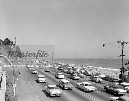 1950s 1960s HIGHWAY TRAFFIC CARS ALONG MALIBU BEACH SANTA MONICA CALIFORNIA USA TRANSPORTATION