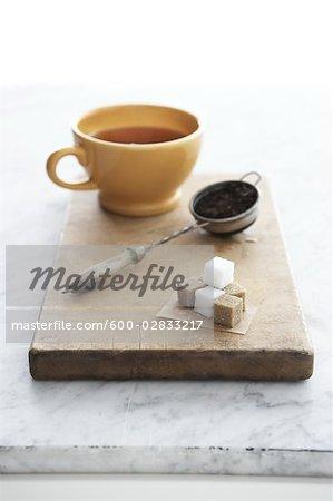 Tasse de thé et passe-thé