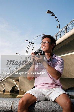 Tourisme en prenant une photographie
