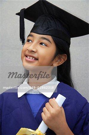 young girl graduate with diploma (close-up)