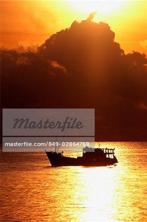 Thailand, Pattaya, Fishing boat at sunset