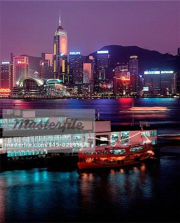 Hong Kong, Night view of Wanchai over Star Ferry.