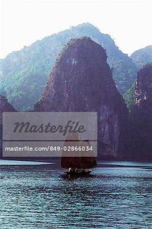 Vietnam, Halong Bay, Fishing junk sailing amongst the islands