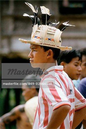 Malaysia, Sarawak, modern Iban boy wearing hat