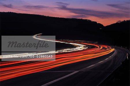 Streaking Lights on Winding Highway at Dusk, Spessart, Bavaria, Franconia, Germany