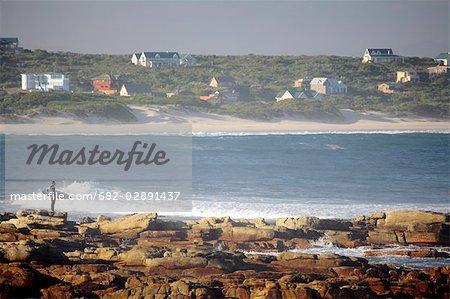 Surfeur tôt le matin, Cap St Francis, Eastern Cape, Afrique du Sud