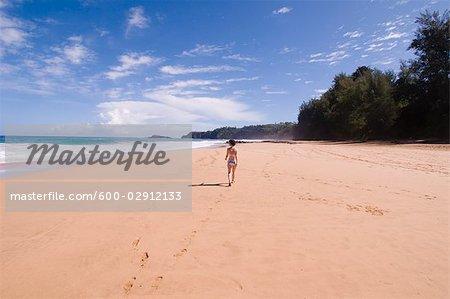 Woman on Beach, Kauai, Hawaii, USA
