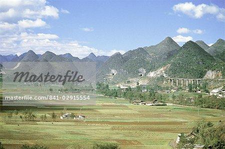 Conical limestone hills and Shanghai to Kunming Railway, Guilin, Shuicheng, Guizhou, China, Asia