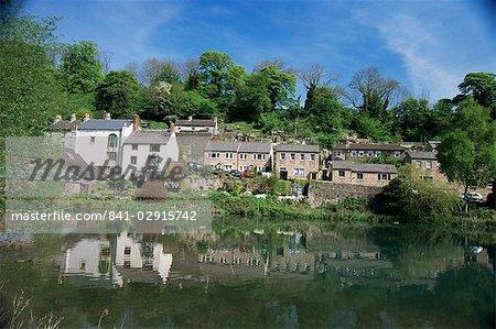 Houses beside the Comford mill pond, Matlock, Derbyshire, England, United Kingdom, Europe