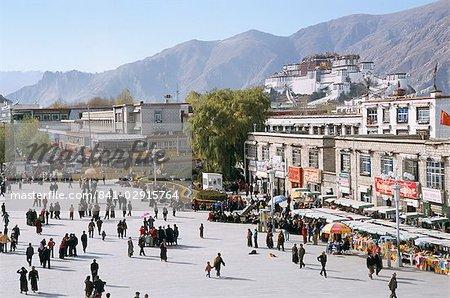 Main square in front of Jokhang, Potala palace beyond, Lhasa, Tibet, China, Asia